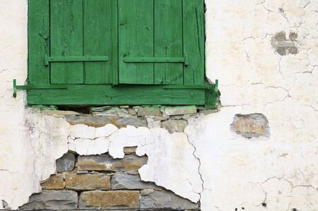 detail of a green wooden window in an old house photo