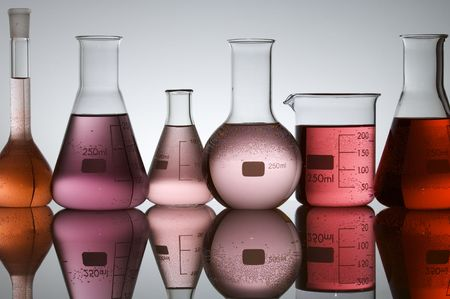 matrass: laboratory glass at backlit with white background