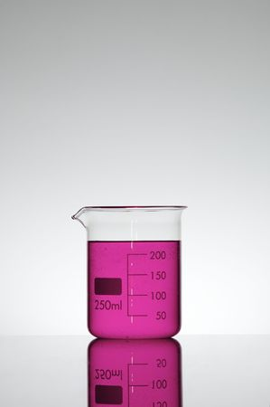 scientifical: beaker with fluid fuchsia against a white background Stock Photo