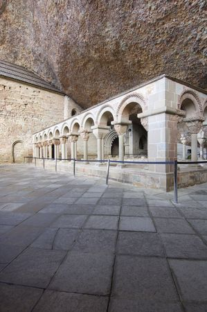 Romanesque cloister in the old monastery of San Juan de la Pena, Huesca, Spain photo