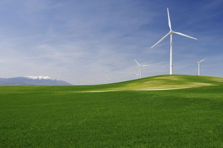 group of windmills in an idyllic green meadows photo