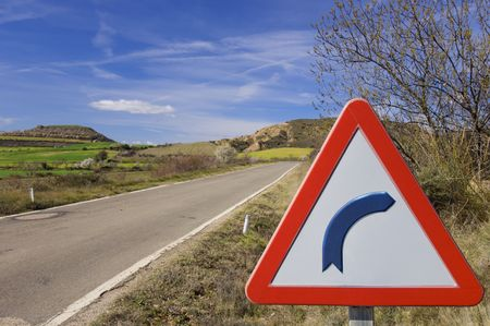 danger signal to the right curve in a highway through an idyllic landscape in Spain Stock Photo - 6778930