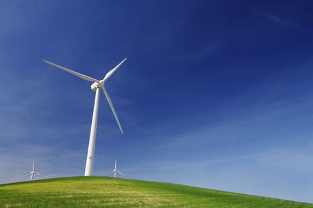 windmills on a green hill with blue sky Stock Photo - 6779254