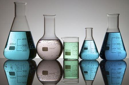 scientifical: five laboratory flasks with liquid and a white background Stock Photo