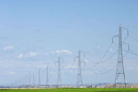 High tension electrical towers with blue sky photo