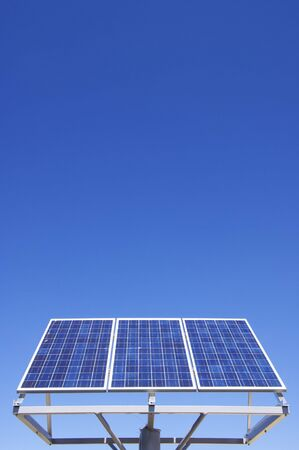 small photovoltaic panel against a clear blue sky photo