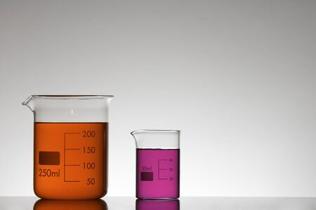 scientifical: two beakers with red and pink liquid