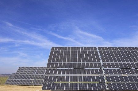 huge solar panels and blue cloudy sky photo