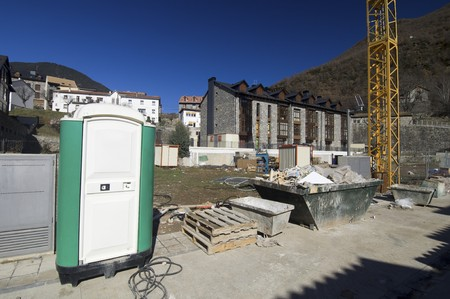 portable toilet at a construction site photo