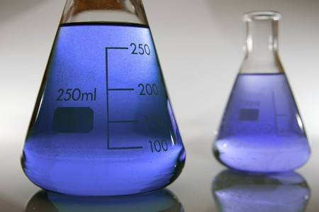 scientifical: two Erlenmeyer flasks with liquid backlit blue and purple