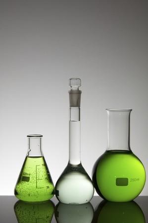 scientifical: three laboratory flasks backlit color liquid