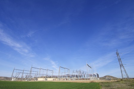 isolator switch: view of an electrical substation and a high voltage electric line Stock Photo