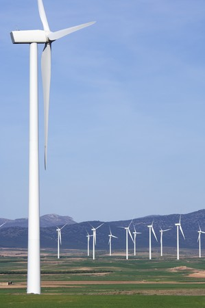 windmills group in a mountainous area with blue sky Stock Photo - 6994852