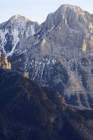 rocky peaks in winter, Pyrenees, Spain photo