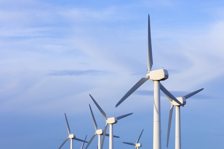 enviromental: windmills group with cloudy sky