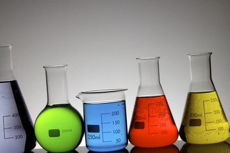 beakers group with liquid against a white background photo
