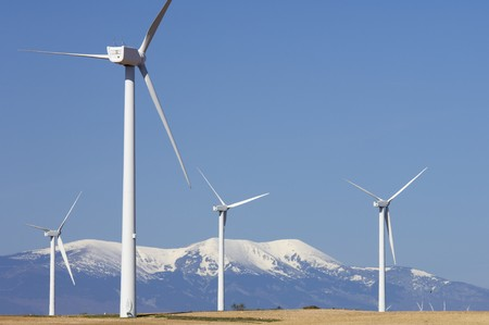 wind mills and snowy mountain with blue sky Stock Photo - 6994948