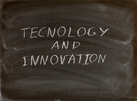 technology and innovation words written on a blackboard photo