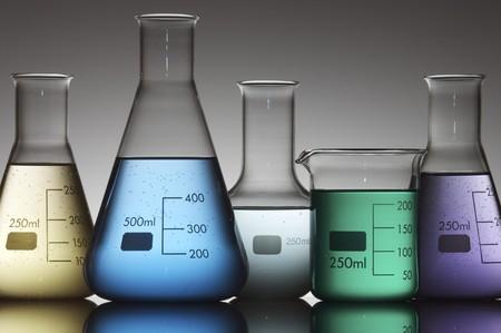 Laboratory flasks on a white background photographed backlit photo