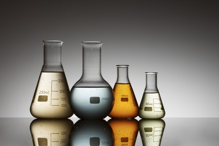 group of four flasks containing brightly colored liquid photo
