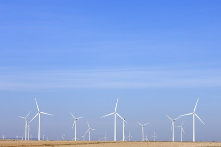 aligned: aligned windmills and blue sky in spain Stock Photo