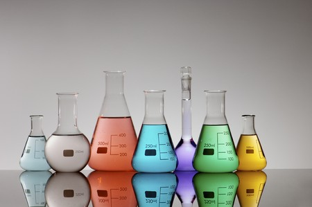 scientifical: group of seven flasks containing different kinds of brightly colored liquid Stock Photo