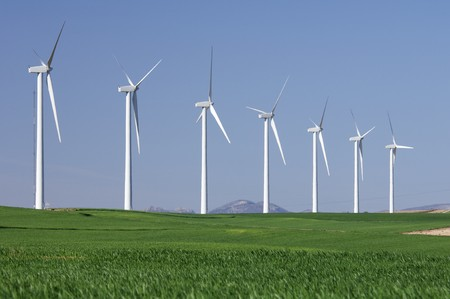 windmills in a field with blue and clear sky photo