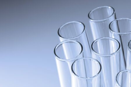 Close the top front of a group of laboratory test tubes in monochrome tones photo