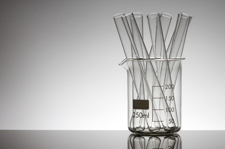 test tubes in a beaker with a white background Stock Photo