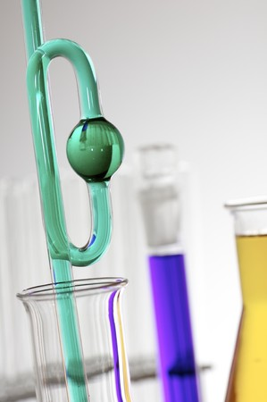 scientifical: forefront of glass equipment in a laboratory