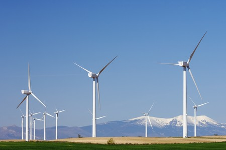 group of modern windmills and in the background snowy mountains Stock Photo - 7042659