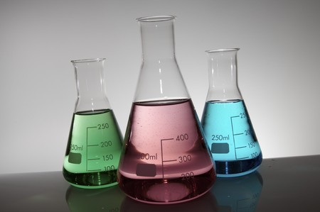 group of three conical flasks on a white lab photo