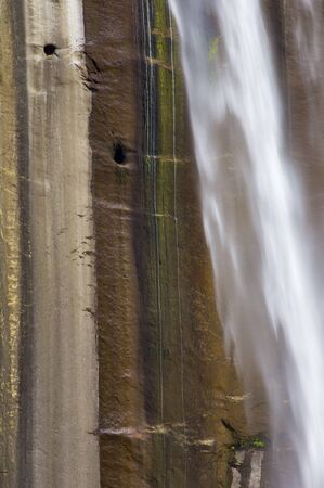 detail of the waterfall known as vernal fall falling on a smooth wall of granite in Yosemite National Park, USA photo