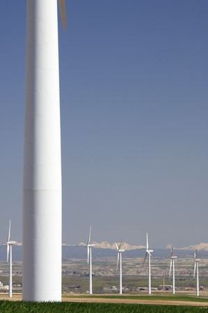 aligned: group of aligned windmills with snowy mountains