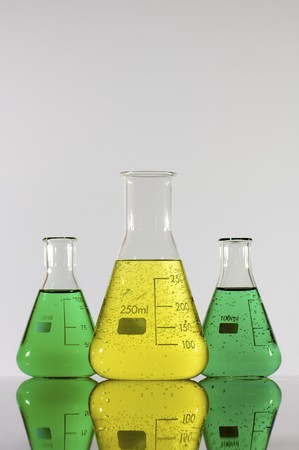 matrass: three beakers with green and yellow liquid Stock Photo