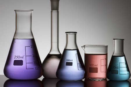 scientifical: five laboratory flasks on a white backlight