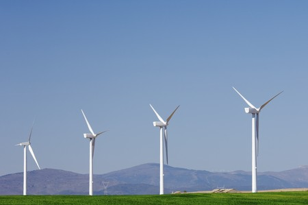 four windmills in a green meadow with clear sky Stock Photo - 7226271