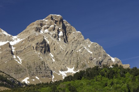 rocky peak: rocky peak in the Pyrenees with cloudy blue sky Stock Photo