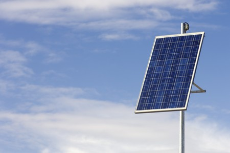 solar electric: little photovoltaic panel with cloudy sky