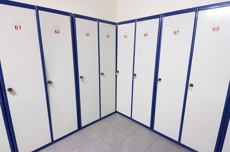 lockers numbered white and blue for clothing and personal items photo