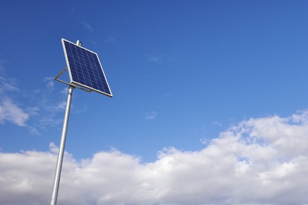 photovoltaic panel: little photovoltaic panel with cloudy sky