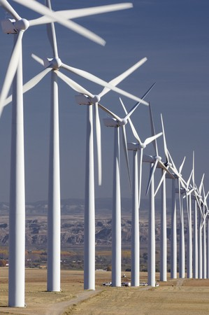 group of aligned windmills photo