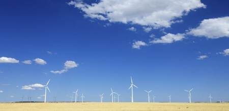 view of some windmills for renewable electric energy production photo