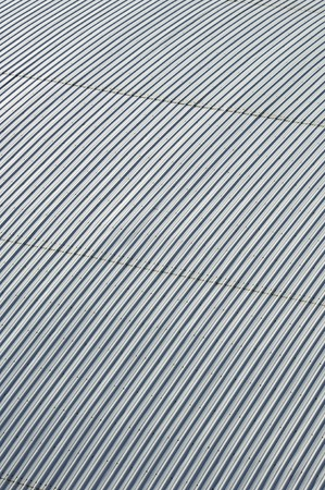 abstract background created by the surface of a metal roof industrial photo