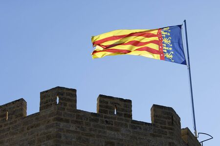 autonomic: Valencian community flag flapping in a tower in the city of Valencia, Spain Stock Photo