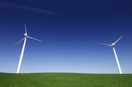 windmills in a green meadow with clear blue sky Stock Photo - 7770632