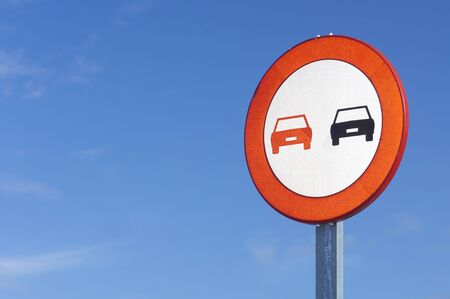 European prohibited overtaking sign on the road ahead photo