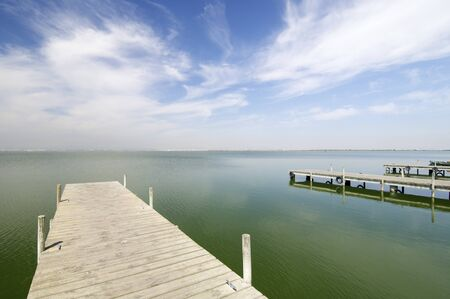 view of a wooden pier in Albufera lake, Valencia, Spain photo
