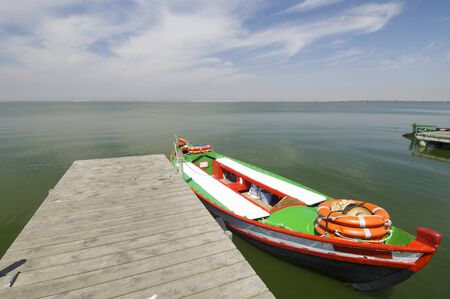 pier and wooden boat in Albufera lake, Valencia, Spain photo