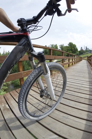 Low angle view of a mountain bike across a wooden walkway Stock Photo - 7770719